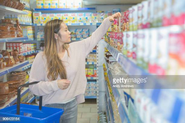 Young woman shopping in a grocery store