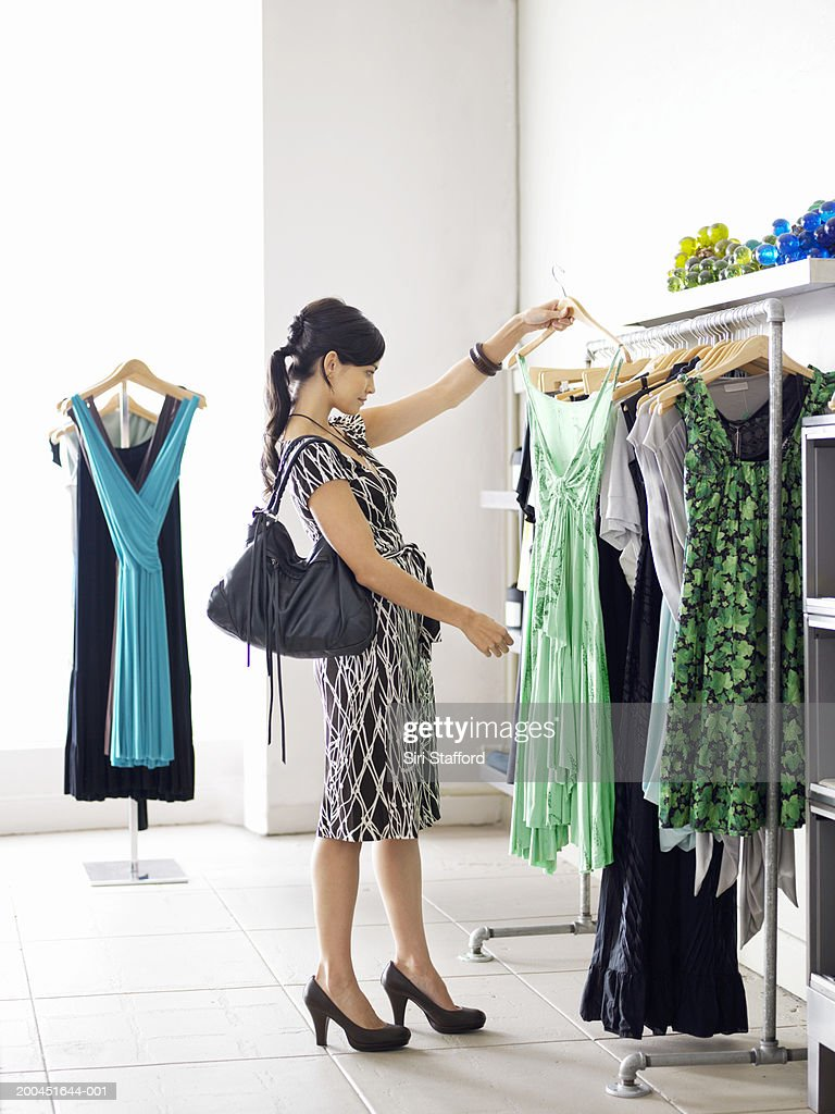 Young woman shopping in boutique : Stock Photo