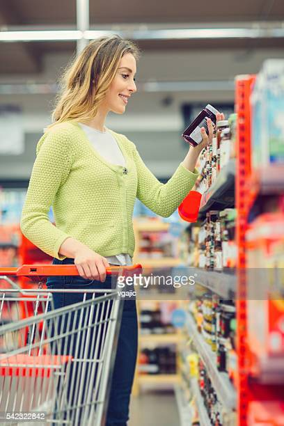 Young Woman Shopping In Her Local Supermarket.