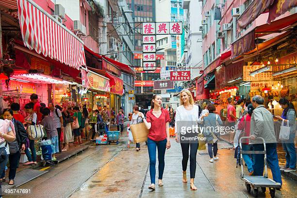 young woman shopping in hong kong - hong kong stock pictures, royalty-free photos & images