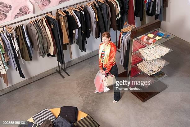 Young woman shopping in retail store, portrait, elevated view