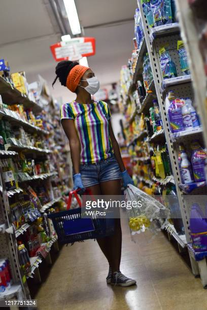 Young woman shopping in supermarket before returning to home lockdown due to Coronavirus in Colombia