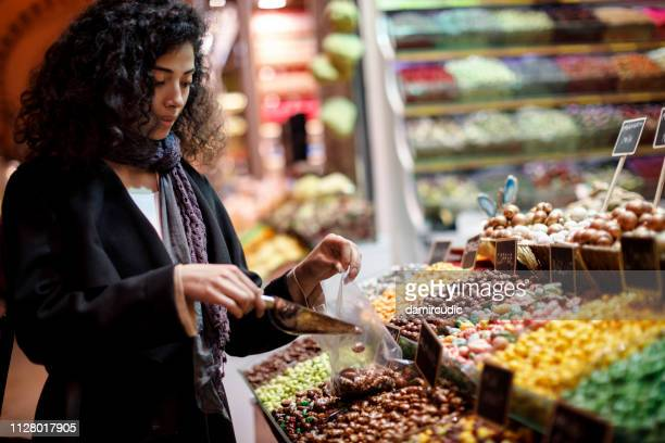 young woman shopping in turkish delight shop in grand bazaar, istanbul, turkey - sweet food stock pictures, royalty-free photos & images