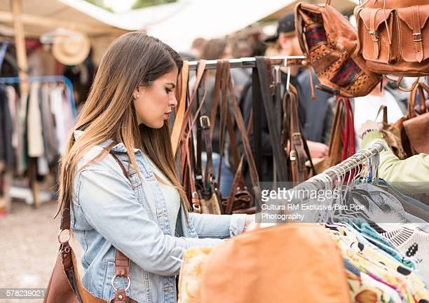 Young woman shopping, Mauerpark Flea Market, Berlin, Germany