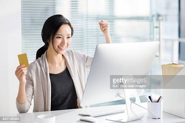 Young woman shopping online in office