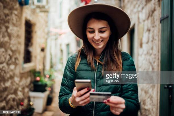 young woman shopping online - charging stock pictures, royalty-free photos & images