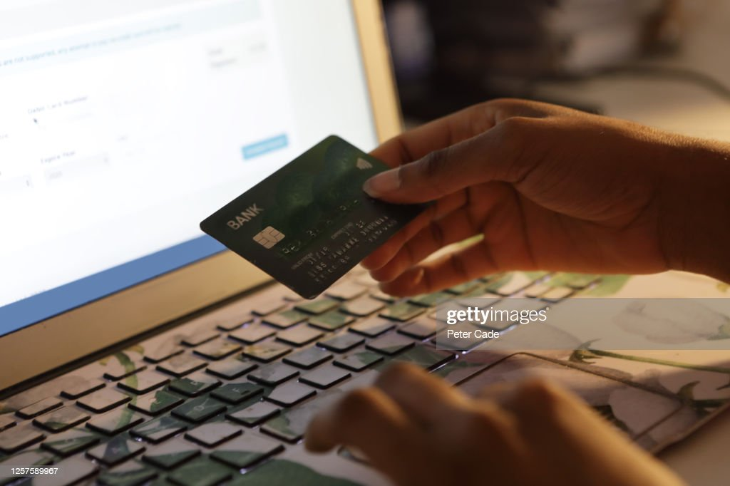 Young woman shopping online : Stock Photo