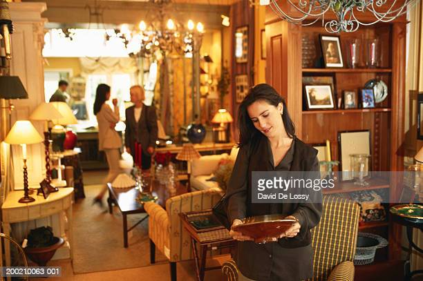 young woman shopping - antique shop stock pictures, royalty-free photos & images