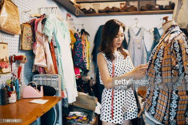 Young woman shopping something in a vintage clothing store