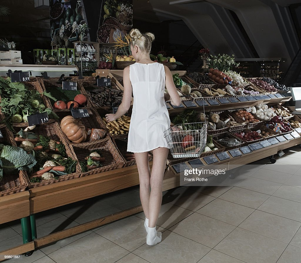 young woman shopping vegetables in mall : Stock Photo