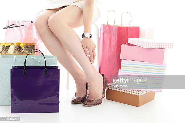 young woman shopping,woman trying on shoes - japanese short skirts stock photos and pictures