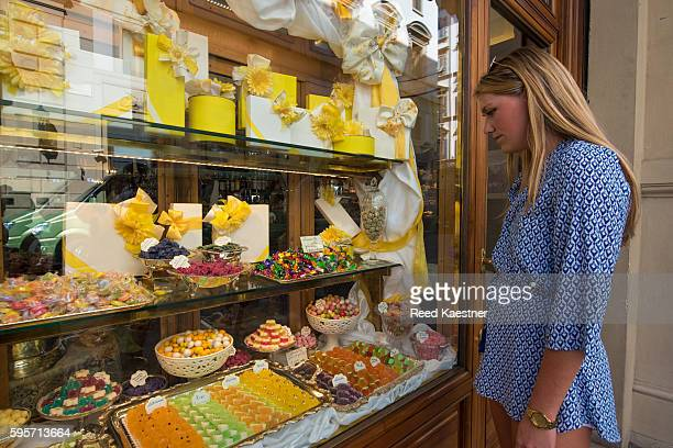 A young woman shops for sweets in Florence, Italy