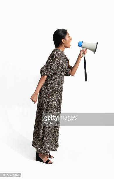 young woman shouting into megaphone - women's rights stock pictures, royalty-free photos & images