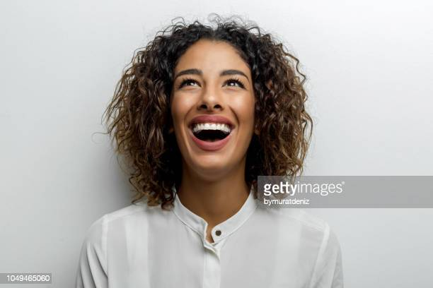 young woman shouting - exhilaration stock pictures, royalty-free photos & images