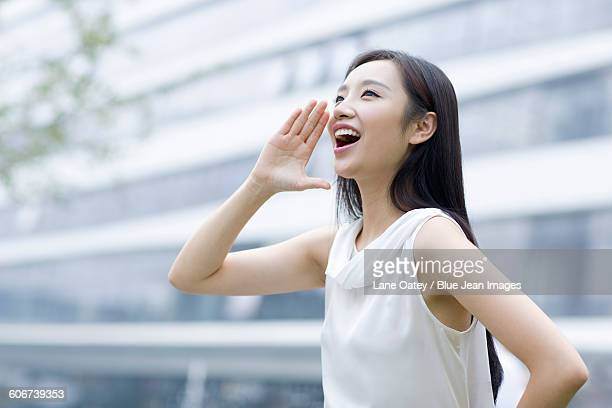 young woman shouting - sleeveless stock pictures, royalty-free photos & images