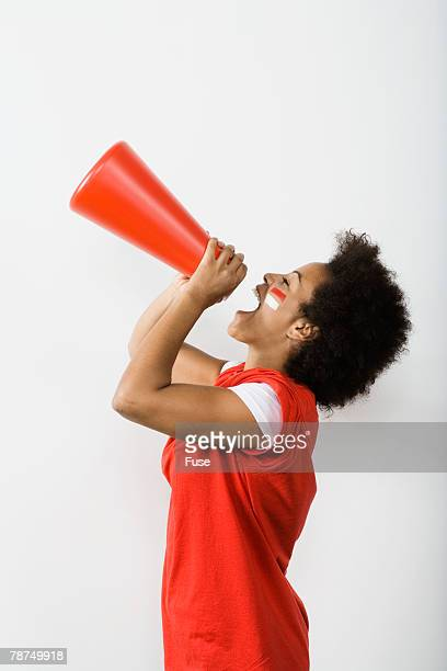 young woman shouting through megaphone - black cheerleaders stock photos and pictures