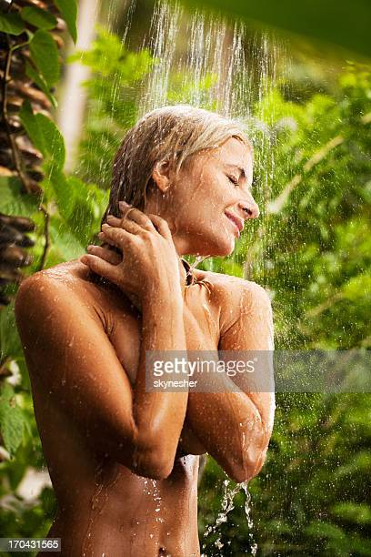 Young woman showering outdoor.