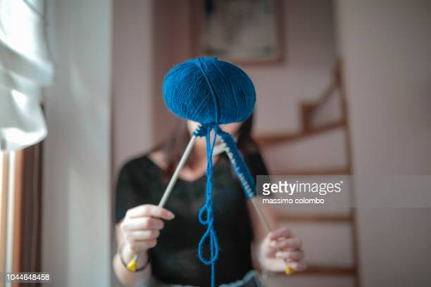 Young woman showing ball of wool