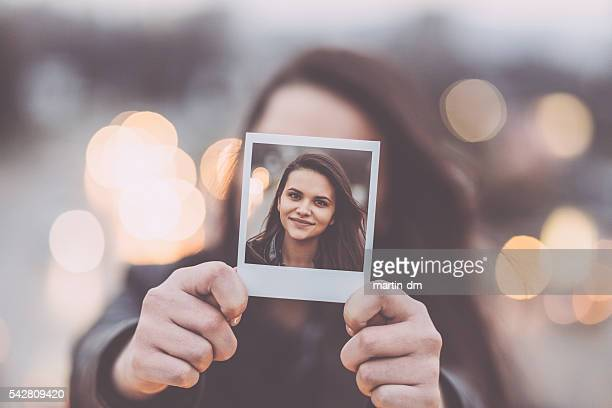 young woman showing instant selfie - nice girls pic stock photos and pictures