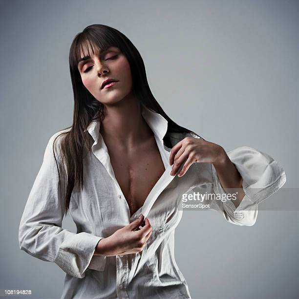 young woman showing off heart surgery scar - heart scar stock pictures, royalty-free photos & images
