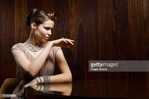 young woman showing off ring - female exhibitionist stock photos and pictures