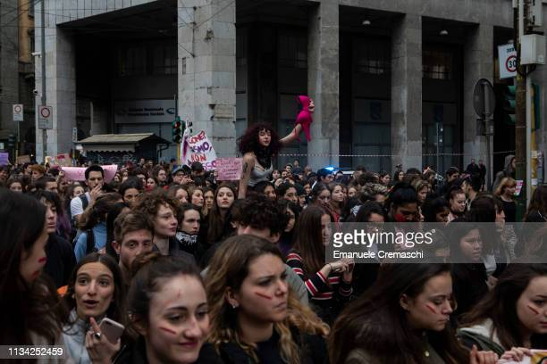 A young woman shows a pink bra while she takes part in a student demonstration against gender violence and calling for gender parity on March 7 2019...