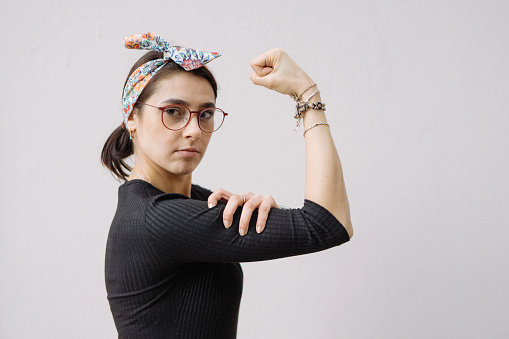 Young woman shows her strong arm - gettyimageskorea