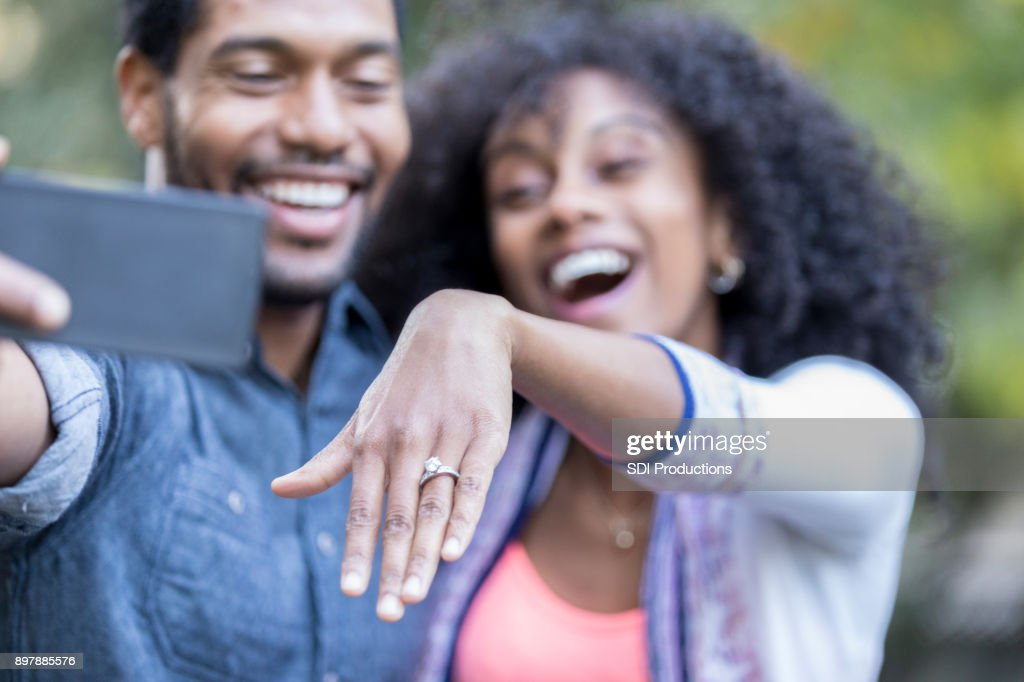 Young woman shows off engagement ring : Stock Photo