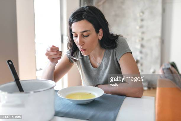 young woman sick at home - soup stock pictures, royalty-free photos & images