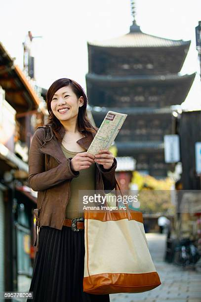 Young Woman Sightseeing in City