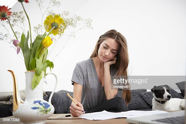 Young woman signing contract