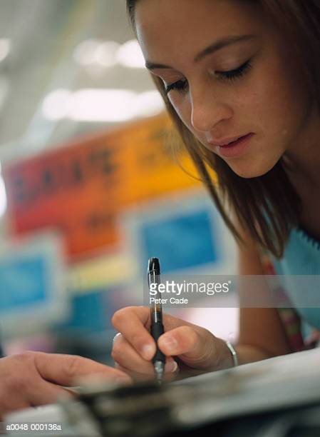 Young Woman Signing