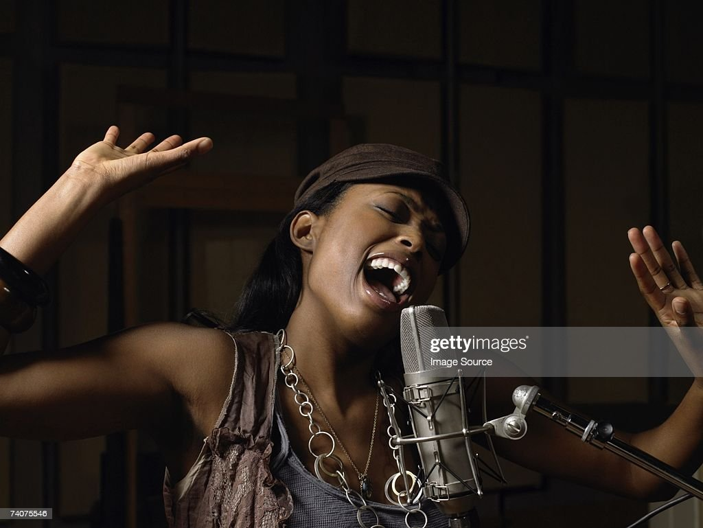 Young woman singing : Stock Photo