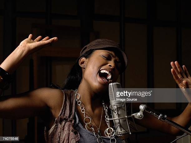 young woman singing - singing stock pictures, royalty-free photos & images