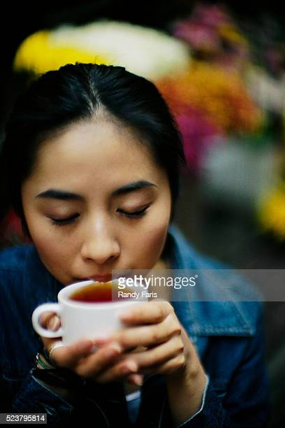 Young Woman Sipping Tea