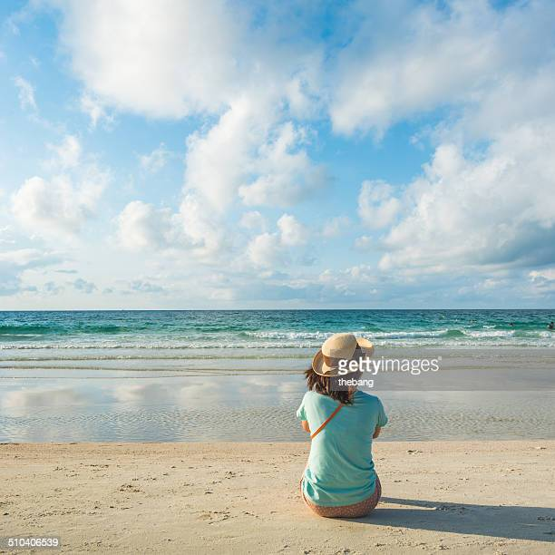 Young woman sit on the beach