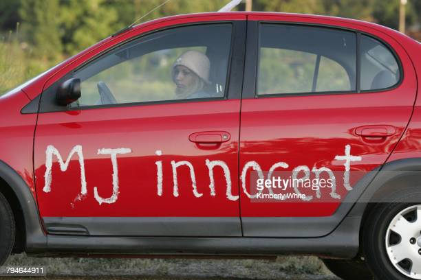 Young woman sits in a car across the street fom pop star Michael Jackson's Neverland Ranch in the hills near the town of Los Olivios Fans from all...
