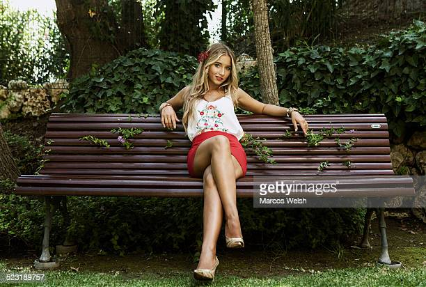 Young woman sitting alone on bench