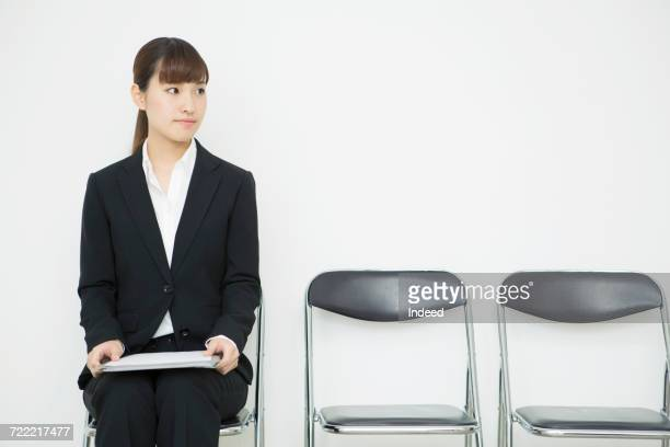 Young woman sitting and waiting for job interview