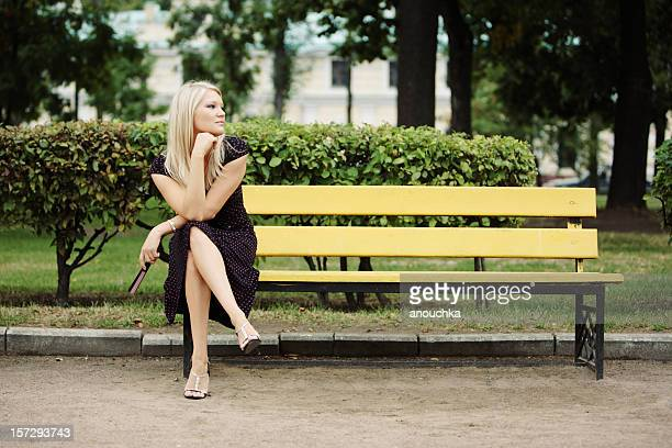 Young woman sitting and Waiting