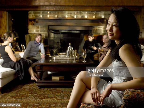 Young woman sitting apart at cocktail party