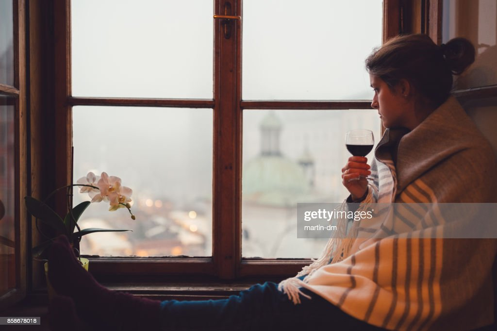 Young woman sitting at home during winter : Stock Photo
