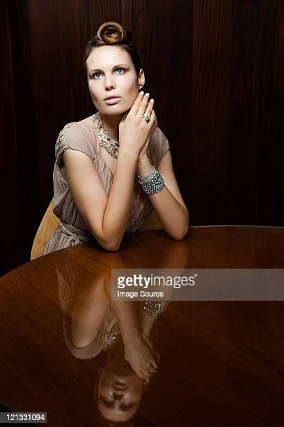 Young woman sitting at table, portrait