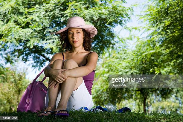 A young woman sitting in a park