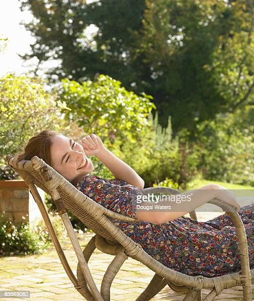 Young woman sitting in garden.