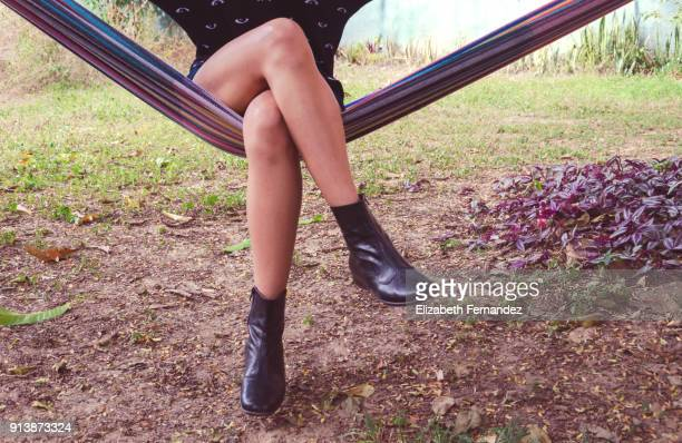 Young woman sitting in hammock