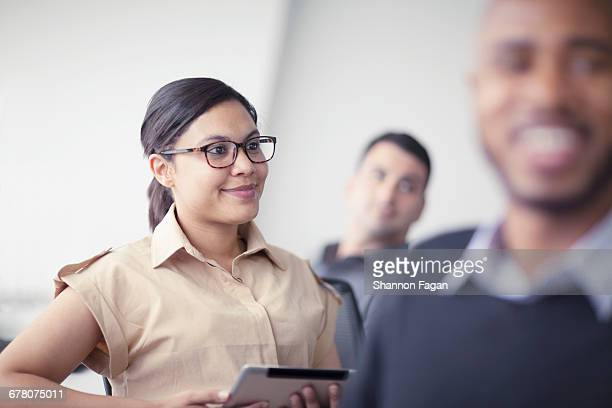 Young woman sitting in office learning classroom
