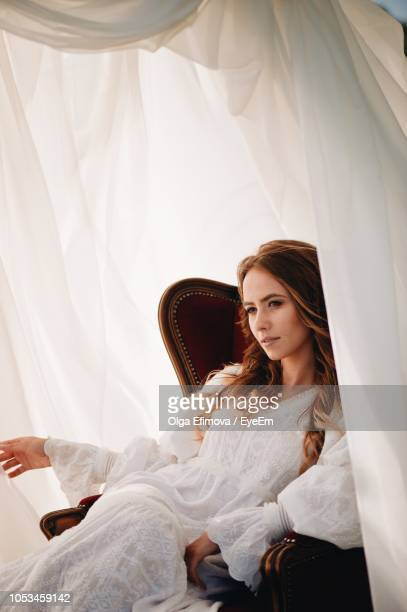 Young Woman Sitting In Tent