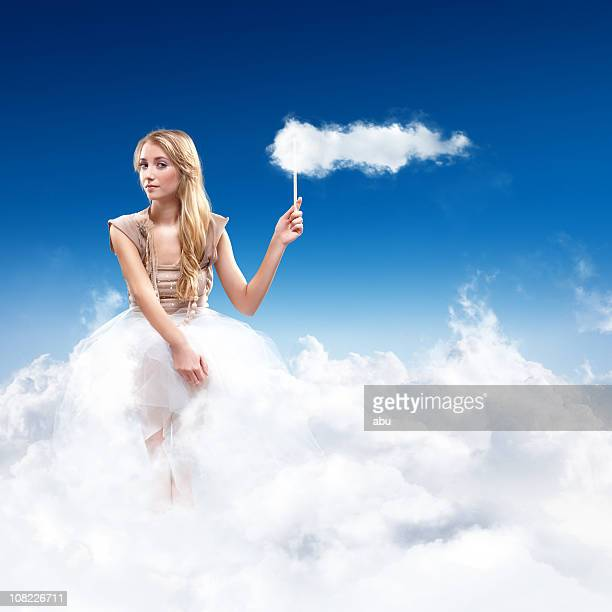young woman sitting in the sky on clouds - cotton candy stock pictures, royalty-free photos & images