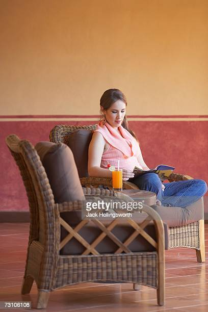 Young woman sitting on a chair and reading